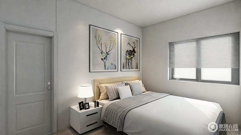 主卧空间不大,设计师尽量以极简风布置,墙面保持白墙状态,与灰白门形成整体性;原木风的双人床上,格纹点缀出一丝活泼,与装饰的对称挂画,释放出清新文艺的自然气息。