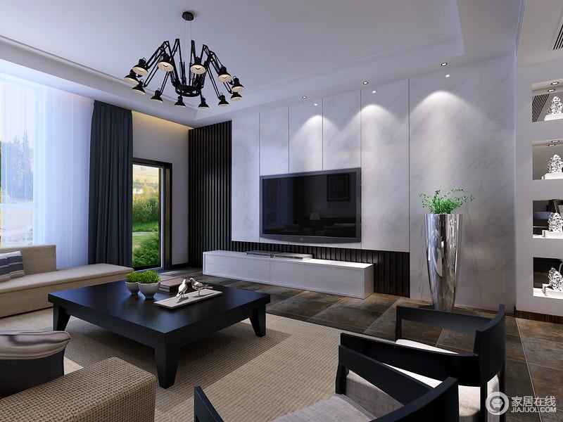电视墙与沙发在设计上异曲同工,材质上的拼接在线条的演绎下,有着灵动感;色调上的黑白经典搭配,赋予空间简约的时尚;低矮的茶几和圈椅造型的座椅,呼应着空间的条木格栅,诠释出几分新中式的韵味。