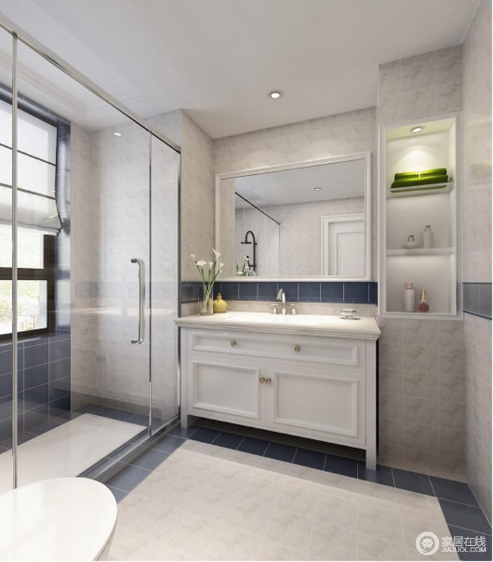 卫生间以干湿分离的设计,让功能分区明确,并易于日常生活;驼色系的砖石铺贴出了朴质,而地面蓝色砖作结构美化,让空间少了单调,多了几何大气,裹挟这盥洗台和墙面收纳柜,让生活更为规整舒适。
