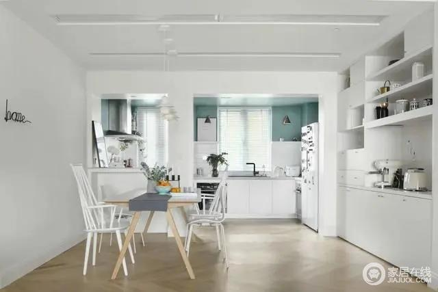 餐厅与厨房以半开放式的空间格局,旁边定制白色的餐边柜,结合简约自然的木色餐桌+白色餐椅布置,使得用餐空间也是充满轻松舒适的气息。
