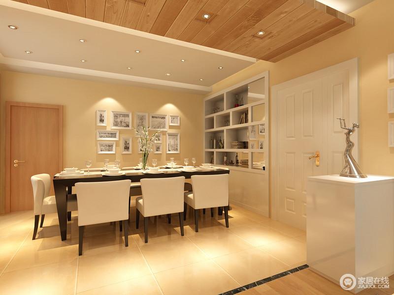 餐厅开放式的设计增强了空间感,白色木门与白色鞋柜给与空间洁净感;木质吊顶起到了简单的分区,米色漆瓷砖渲染着中性和暖,而储入式储物柜与黑白照片墙,组成几何之美,现代家具陈列其间,足显大气。