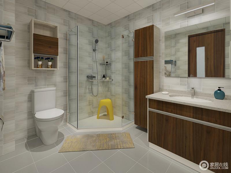 卫生间根据空间的格局,将转角打造成了一个淋浴室,干湿设计更为分明,地垫的铺贴多一份贴心;而灰色系砖石的纹样颇有不同,铺贴出一种简洁之美,从盥洗柜到悬挂柜,也将实用进行到底。