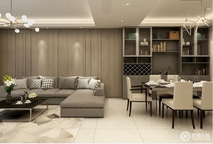 本案例是现代简约风格的,沙发背景墙与酒柜都采用的胡桃木色,显得空间感比较大,视觉上提升感触。