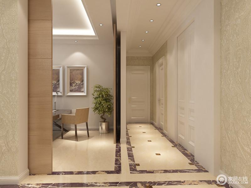 走廊天花装置了一排射灯,营造出的顶光源打照在地板拼花上,与地面上的方块拼花呼应;墙面上淡绿色的印花壁纸与白色的门框结合,铺述出清新素雅的空间氛围。