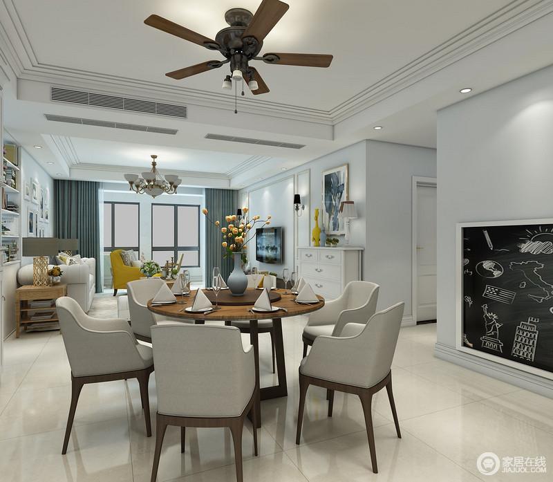 开放式的空间让客餐厅都较为宽敞,浅蓝色漆淡淡地色彩格外平静;黑板墙的设计更让生活多了很多趣味,现代圆桌与餐椅时尚而得体,让空间之间形成互动,却让生活富有品质。