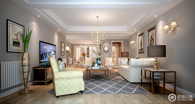 浅淡空灵的灰色背景空间里,乳白与姜黄沙发增加活泼的气氛,菱纹线条带来活力动感,茶几、边几金属裹边则使幽深的空间里洋溢着低奢的华丽。