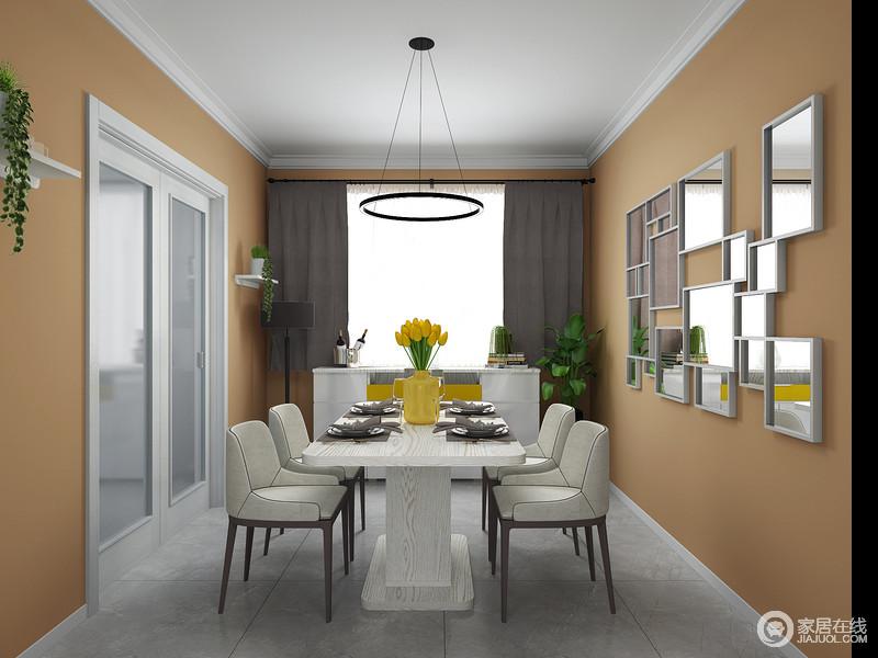 餐厅橙色漆粉刷墙面,让空间具有了夺目和耀眼,让人再无压抑的情绪,墙面的装饰画以几何设计减去了平淡,多了份精致;浅灰色地砖和米色系家具组合,增加空间现代感的同时,平衡着冷暖,也调和出了空间的时尚气息。