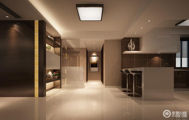 设计师延续了客厅的材质和色调,棕咖、米白与驼色交叠出空间高阶沉稳的气质,加上点和面的布光手法,愈加显得空间内敛幽雅;开放式的厨房利用休闲吧台划分空间,置物柜兼具功能性和装饰性,空间由此被构建的时尚且实用。