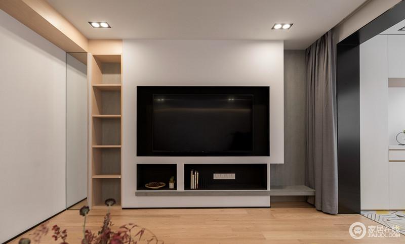 客厅的电视墙是直接用墙面镂空而得,镂空的墙面用灰色的壁纸装饰,灰色和白色美观简约,十分符合现代的潮流;电视墙还起到一个增大存储空间的作用,放几本书在镂空格上方便随时取阅,褐色的松子和绿色的多肉可爱且养眼,让空间的视觉层次更加丰富;电视墙旁边的玻璃镜打开便是储物格,解决了收纳。