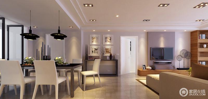 客厅与餐厅间并无明显分隔,但区域上有着各自的独立;走廊正对着的边几与照片墙及摆件搭配出风景线,无形中起到两厅连接作用。