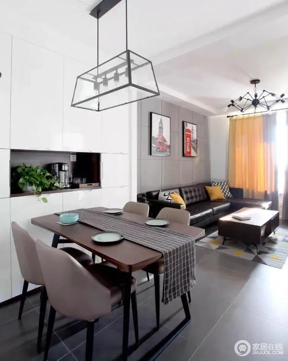 开放式空间自带自在感,深胡桃餐桌与黑色桌腿搭配,让这种简洁的家具造型,表现出了高雅的格调。