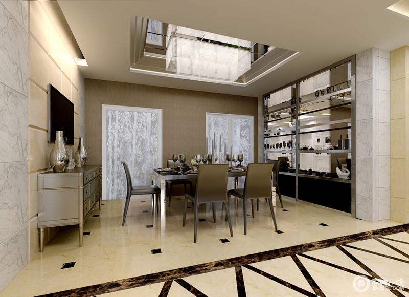 餐厅的拼接点状的黑色砖和线条让地面更有动律之美,加上米色砖的搭配,具有简洁之美;金属收纳架和现代风的家具构成空间的闪耀。