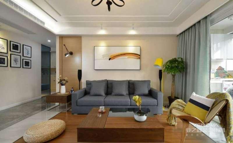 沙发背景墙上的挂画是这一区域最大的亮点。