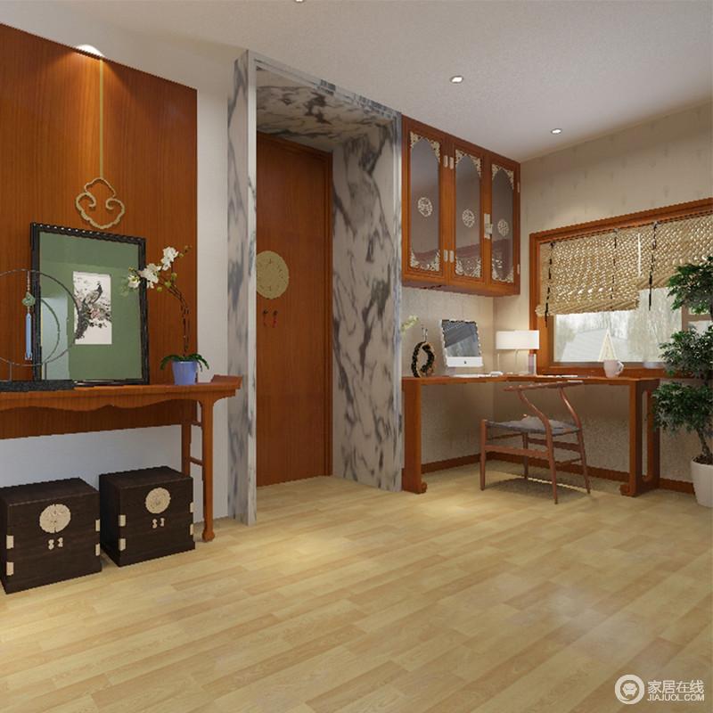 书房大理石的门框与原木地板给人回归原始的状态,红色墙面搭配中式木几、书桌等,凑成空间的东方品质,挂画、箱体收纳小柜等与之组合,让家极富东方文艺气质。