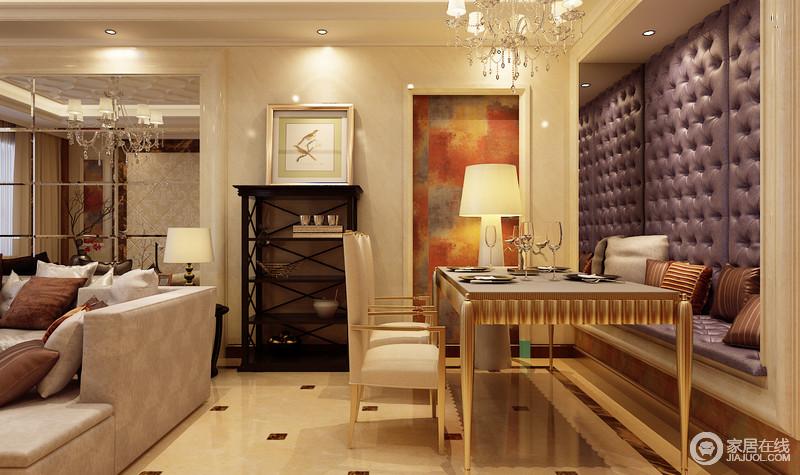 餐厅位于客厅一侧,利用沙发和高靠背餐椅划分区域,混搭的卡座设计,采用紫色绗缝软包,折射在镜面中,渲染出神秘高雅的气质;装饰的油画色调缤纷,并与卡座底部呼应,整体富有张扬的华贵感。