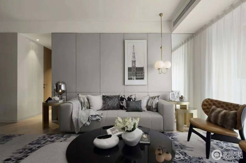 简约风格黑白灰客厅没有过多的色彩搭配,舒适的布艺沙发,灰色调的墙面,让整个客厅空间增添了一丝时尚的气息。