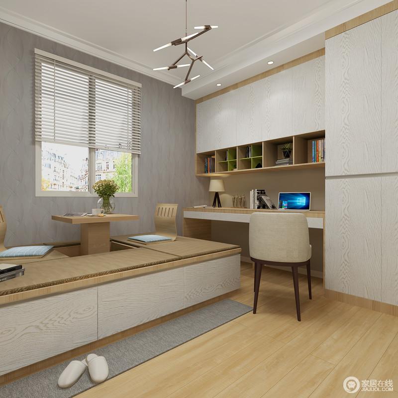 书房的设计以功能性为主,通过定制得书柜和榻榻米,提供一个藏书和休息区,设计分明,动线清晰,不缺实用性;浅灰色漆粉刷墙面与木地板构成色彩反差,让空间和谐而温和。