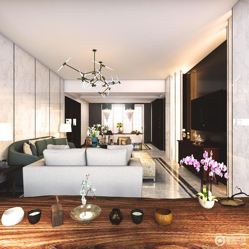 客厅背景墙采用黑白对比的色调,形成空间视觉上的层次感;灰色与深草绿色的沙发组配搭,在骨节吊灯的点缀出,有着沉稳大气的时尚感;阳台上,朴质的茶几和摆件,则与空间格调制造出冲突的美学。