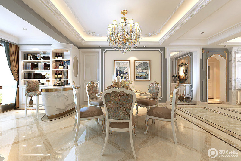 印花与雕花相映成辉的咖白餐椅,搭配着白色圆形餐桌,组合出餐厅空间;灰蓝白修饰的背景墙连接着休闲吧台,并以吧台无形中做以空间的划分;椭圆形的吧台上弧形的酒架与书架相连,围合出休闲一隅。