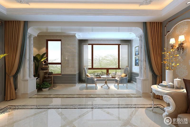 走廊空间相对宽敞,与之相连的阳台也显得开阔大气;蓝驼色布艺大胆搭配,装饰着灰白拱形罗马柱,显得高雅端庄;不规整的阳台上,设计师根据空间布置了自然景观和休闲座椅,大玻璃窗引入室外自然,为空间注入了悠闲随性。