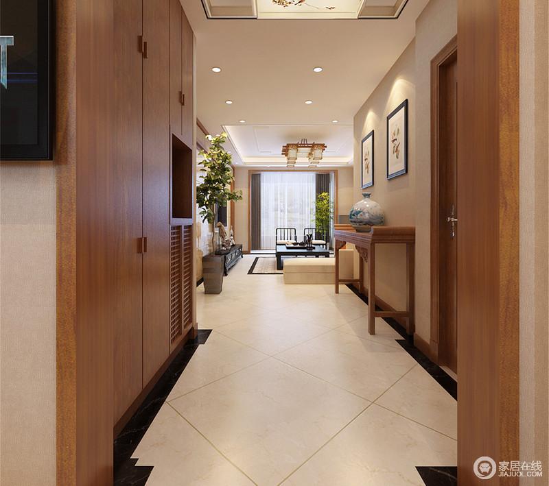 客厅与走廊移门效果图_一层正对着门的玄关走廊上,设计师利用顶天立地式壁面柜做了 ...