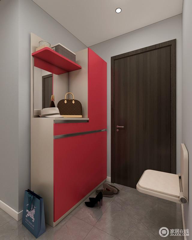 门厅的墙面粉刷了灰色漆与深灰色的砖石形成鲜明的对比,却让空间具有朴质感;红色定制得鞋柜恰当地利用空间实现了功能性,可缩放地鞋凳更是贴心,让主人回到家的时候,可以轻松换鞋,入室休息。