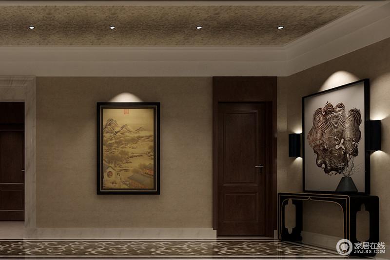 门厅空间十分宽敞,驼色壁纸与大理石地的复古样式,成就空间的厚重;中式实木安吉搭配写意画,延续了东方艺术,而现代壁灯与灯珠的照明,让空间具有展陈美学。