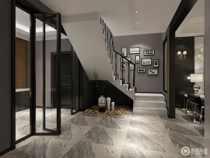 走廊中以灰白色大理石自然的纹理来体现立体之美,结构感强劲的楼梯以简单的曲线和直线更显建筑美;灰色墙面上的艺术画组合出庄雅,角落的石头、花器带着清隽和简约添置着宁静和清禅。