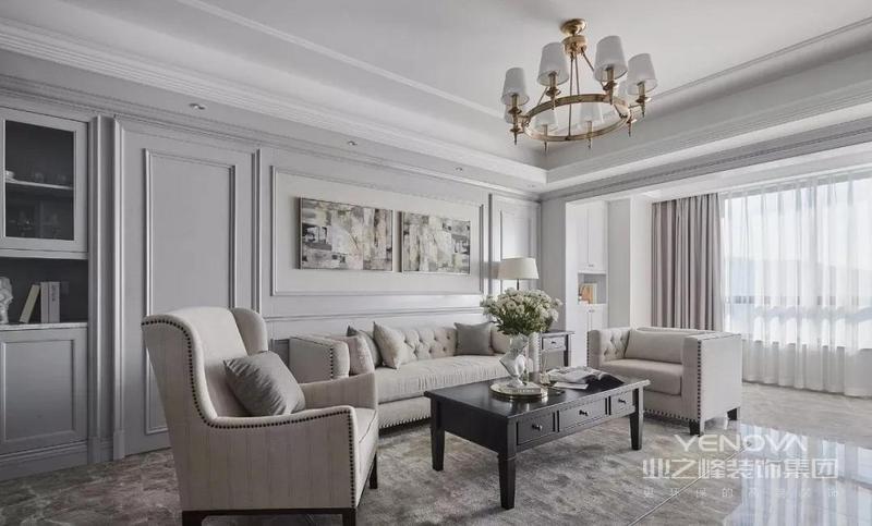 客厅整体以现代美式为格调,地毯与装饰画呼应,隐形门与灰色系护墙结合,使背景墙保留其完整性与对称性