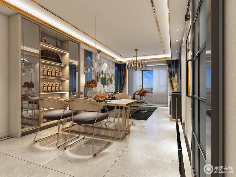 餐厅与客厅仅一步之遥,可以说空间的功能感十足;餐厅利用墙面空间,隔出酒柜,搭配家具,营造了一个较为现代的温情空间。