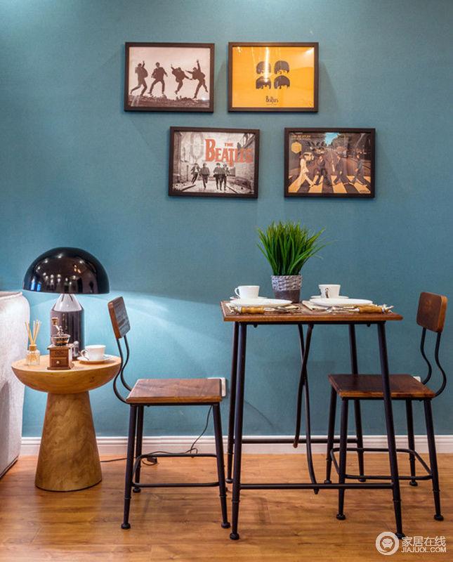 餐厅简单却温馨,铁艺结合原木的餐桌椅工艺风十足,温暖的灯光搭配墙面上后现代主义装饰画,营造出一种小咖啡厅的氛围,让用餐过程也能充满艺术气息。