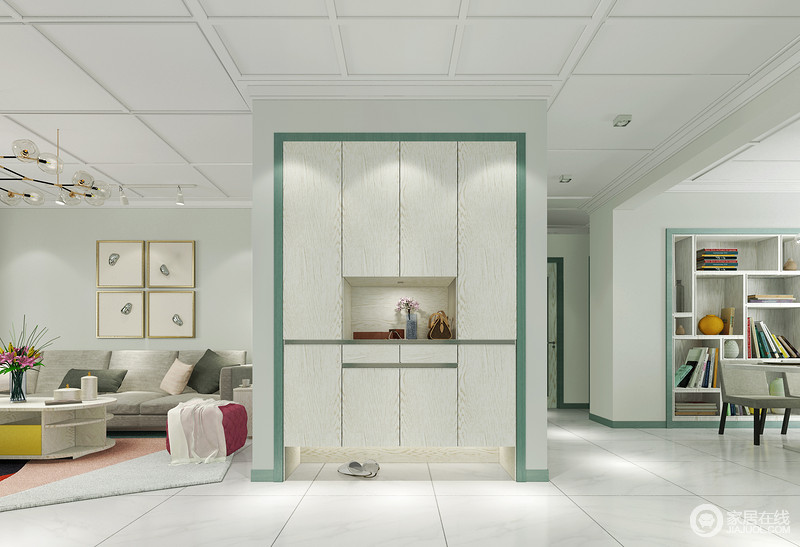 门厅的空间其实没有太过明确的划分,与整个空间以动线区分,也多了空间性;正对着的玄关柜定制设计,极具收纳性,白色板材因为绿色木条框的装饰,让原本白色地砖的纯净里多了份生活的生命力和新鲜感。