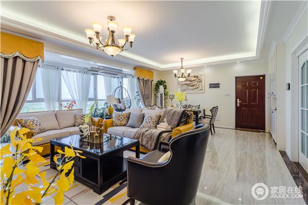 客厅与餐厅通过动线和家具自然分隔空间,统一地吊顶让空间尤为和谐;现代美式沙发灰色之中多了橙黄色的亮丽,黑色铆钉扶手沙发,更多了古典优雅,让生活不失质感。