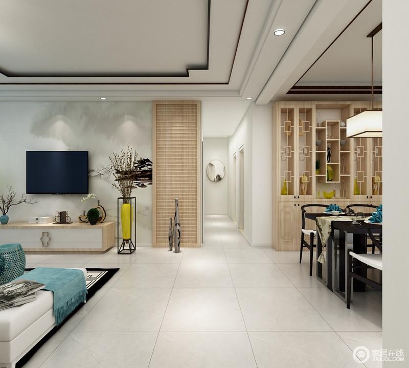 客餐厅一体式设计自带开放与自在感,浅灰色地砖平铺出几何感,定制得实木展陈柜以东方元素表达收藏艺术,留白的整体空间,不失中式的沉着,又能体现现代明快的氛围,给人新中式的和静。