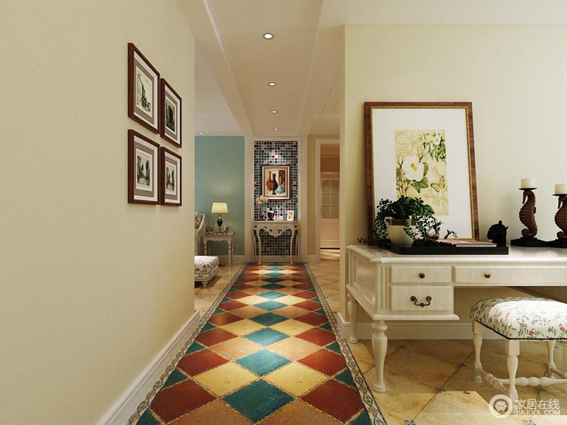 整个空间以规划有序,虽然空间之间以结构作区分,但是,互动感的设计更显自在;在米色调的基础上,立面以蓝色马赛克拼砖表现精致,搭配古典白色边柜和挂画,让生活具有艺术气息;彩色地砖的异域特色,无疑为空间带来色彩和活力,更是带来了些许异域风情。