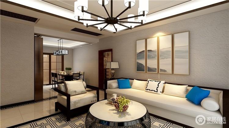 新中式风格的家具搭配以古典家具或现代家具与古典家具相结合,让原本线条简练的空间,多了东方格调;背景墙的云墨图带着抽象之美,与中式家具构成大气。
