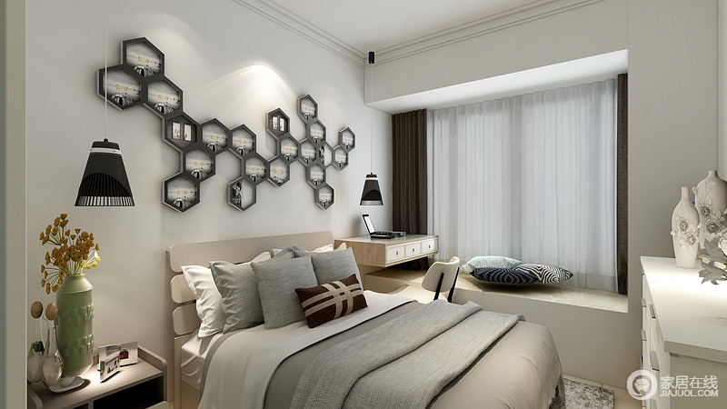 卧室线条简单,虽然面积有限,却利用飘窗来放大空间的功能性,搭配一组边柜,颇为实用;多边形墙饰点缀出现代艺术,与灰色床品组合出一种冷色之美。