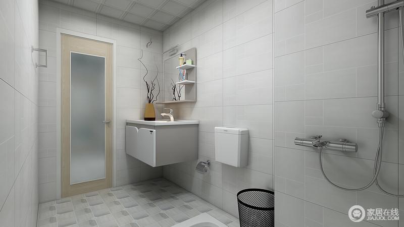 卫生间浅灰色几何线的砖石铺贴墙面,与地面渐变地的砖石构成冷色时尚;方形盥洗柜与镜面收纳架功能多样,以大空间的设计,让沐浴也更为放松。