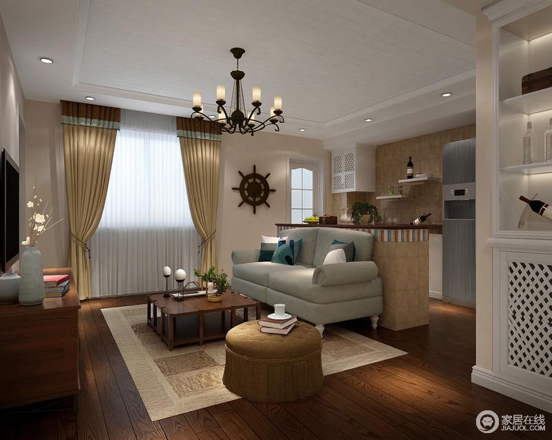 客厅使用褐木地板、米色立面、土黄色窗帘、麻制制品将田园的天然感和粗狂表现出来,虽然空间的不大,但是设计师利用吧台将客厅与厨房分开,明确功能性;铁艺吊灯与挂式让空间不空寂,更朴实。