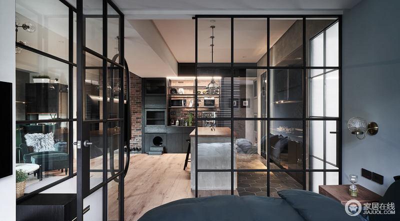 空间采用全透明的网格子玻璃门来区分空间,既不影响空间的各自格局,又不影响空间的采光;餐区利用水泥砖和木地板加重空间的工业气息,同时,黑色系的橱柜更是以收纳设计让生活更为合理和有条理。