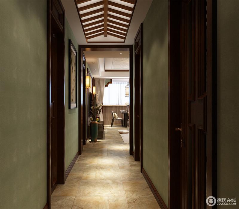 清静悠逸的绿色墙面,搭配雕木梁阁门栏,给人一种自然淳厚含蓄的美。将怀古的浪漫情怀与现代人对生活的需求自然衔接,呈现出简洁而通透的门厅。