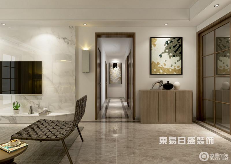 空间采用点线面的构图方式,令空间显得张弛有度;客厅搭配的那把悠闲椅的曲面宛若一个拥抱、 一张大手,平衡了空间矩形元素所带来的肃感和肌理的光泽;细品墙上的两幅挂画,意境关联的宛如姊妹篇,遥相呼应的印入眼帘。