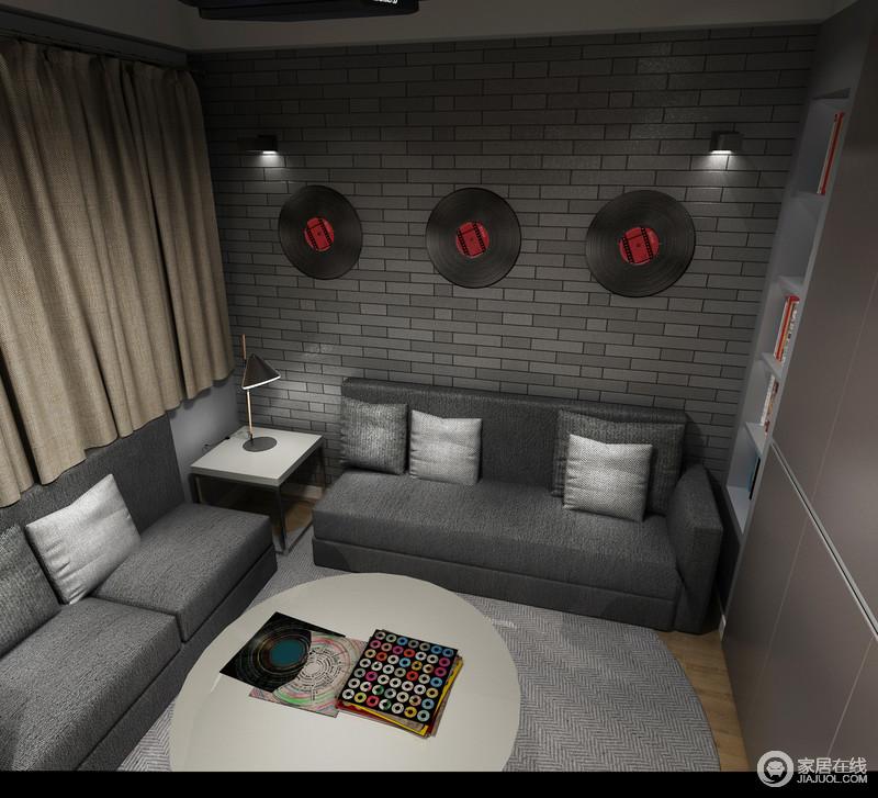 影音室内,灰色的文化砖铺贴出一种新中式的味道,深灰色沙发搭配浅灰色地毯,渲染出沉寂的气氛。