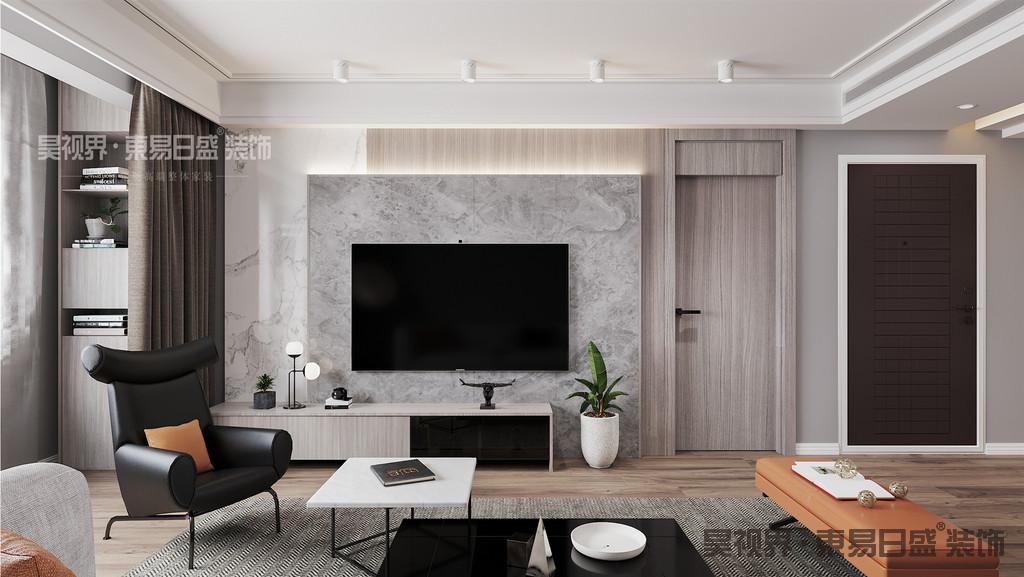 """电视背景处给现代客户装修一个新的思路。很多业主会遇到电视背景墙处有门的问题,并不是有门就一定要刻意做""""隐形门""""的。其实通过材质和设计手法的运用使背景墙的门很好的融入整体的背景墙中不为是一个很好的选择。"""