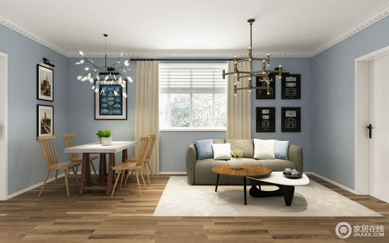 客厅以浅蓝色为墙面着色,与白色吊顶恍如天空般的清和,十分简淡和气;不同的艺术画张贴在客餐厅一体式空间,将艺术语言贯穿其中,与造型迥异的台灯以文艺让北欧实木家具和沙发的朴素愈显自然。