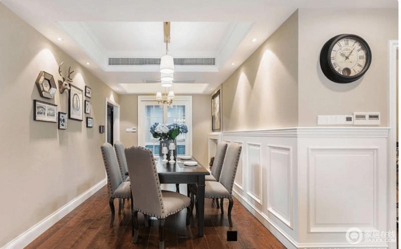 木质的餐桌搭配皮质的餐椅散发着浓郁的美式气息,墙面上的装饰,为空间添了一份艺术色彩。