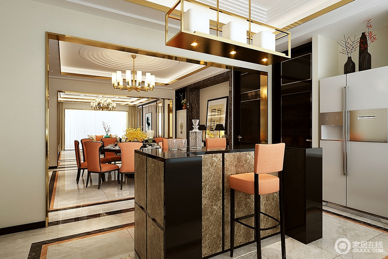 吧台延续了整体设计的精妙之处,以简练的线条和开放式格局将其他空间的设计气息吸纳进来,饱满而活跃;大理石L形吧台在橙色吧凳的衬托下色彩明艳,与黄铜蜡烛吊灯镌刻着工业艺术的独特和摩登。
