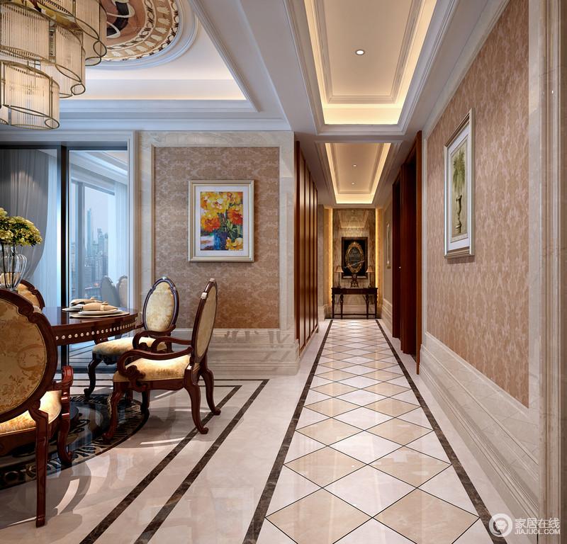 走廊虽然上下都是矩形,但是石膏吊顶内嵌入的灯带和菱形拼接砖的效果,在延续矩形规整的同时,以菱形砖来彰显样式设计给予空间的大气。