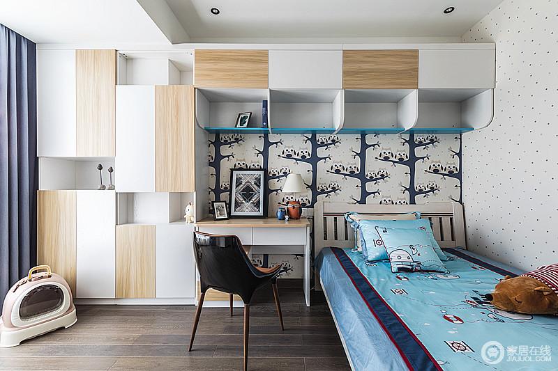 儿童房定制得柜子,以白色和木色搭配,穿插的设计更显个性,也张扬着实用主人的智慧;黑白色的植物元素壁纸与蓝色床品以不同的多元素搭配出时尚,让整体家的感觉瞬间活波起来。
