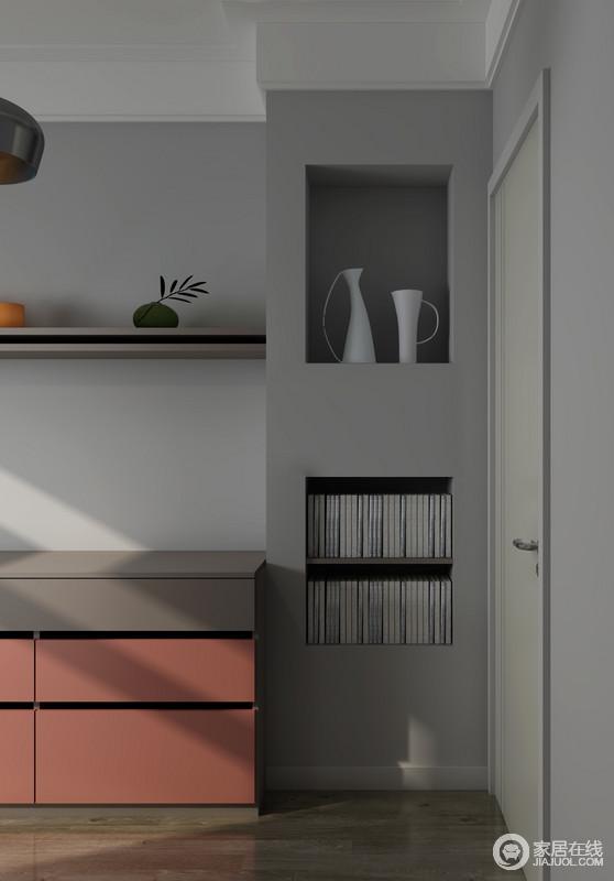 设计师有心的利用墙体做了一个储物格,花器和饰品的点缀,让空间更具美学。